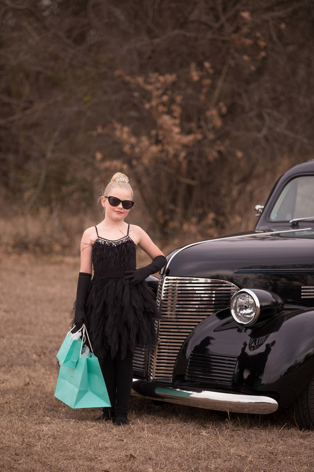 Breakfast at tiffanys inspired outdoor portrait with a classic car in arlington tx