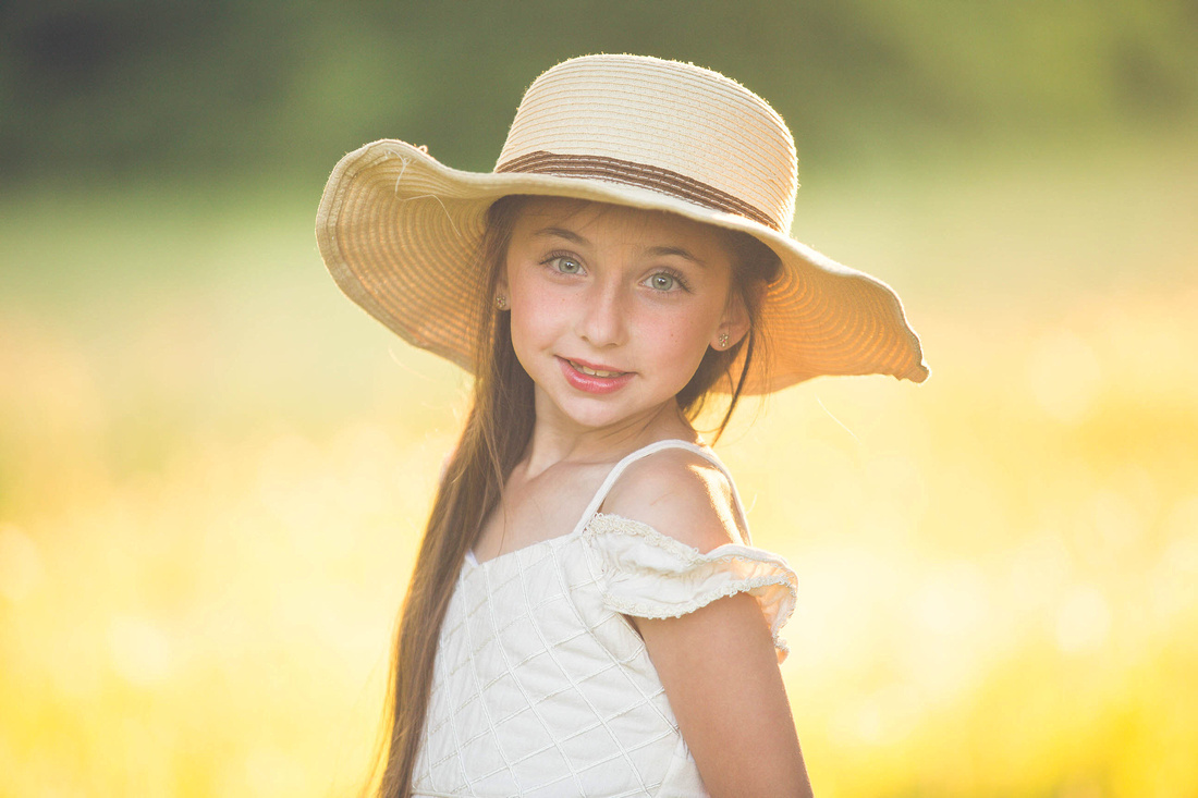girl in summer with a hat portrait in fort worth tx