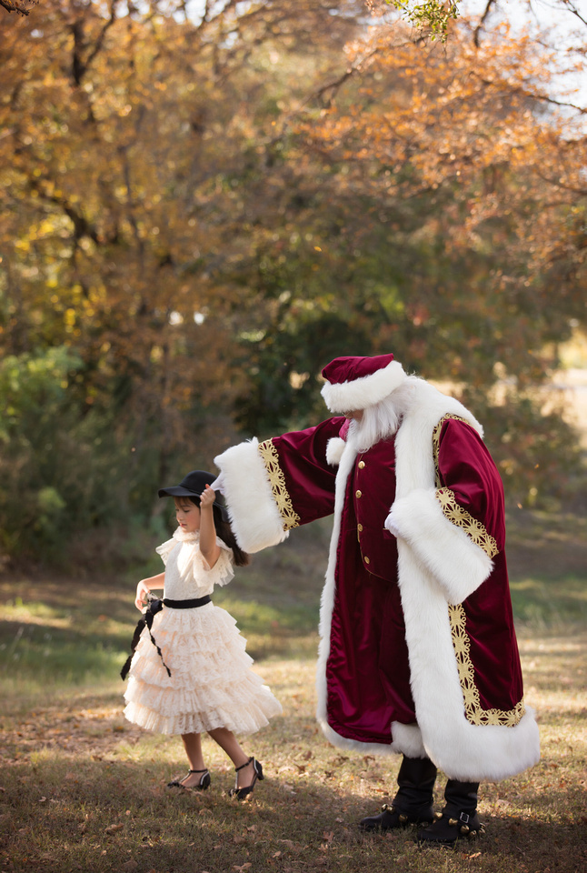 girl dancing with santa in couture gown