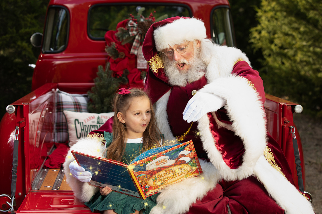 girl seeing magic being added to book with santa